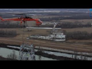Тяжелый транспортный вертолет с системой канатных крепежей