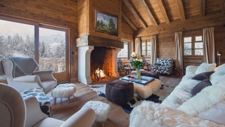 The sound of burning firewood in the fireplace. Log cabin in the snowy mountains.