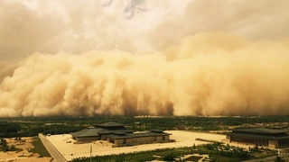 Dramatic footage of a huge sandstorm engulfs buildings in In North Western China