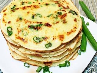 БЛИНЧИКИ С ПРИПЁКОМ  (зелёный лук и сыр) Crispy with green  onions and Parmesan Cheese.