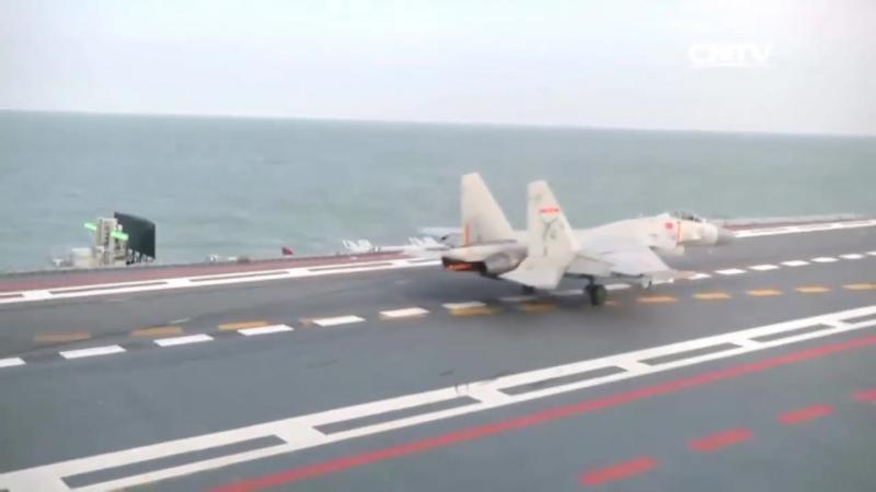 CNTV J 15 военно морских истребителя Испытание несущей 1080
