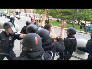 Just about an hour ago, police officers shove man in Niagara Square to the ground WARNING .mp4