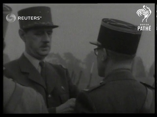 DEFENCE: General de Gaulle and Admiral Muselier present medals (1941)